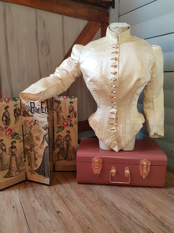 Beautiful and old corseted jacket in 1870's. Antiq