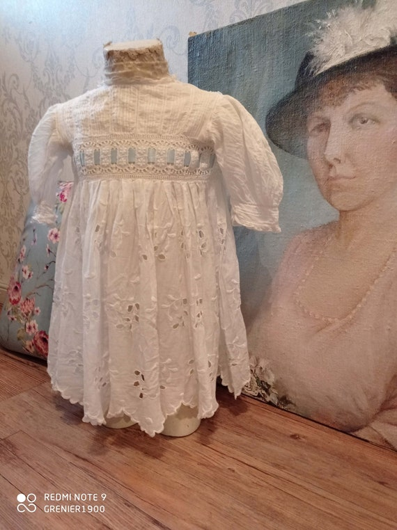 Lovely little old white girl dress and her ribbon.