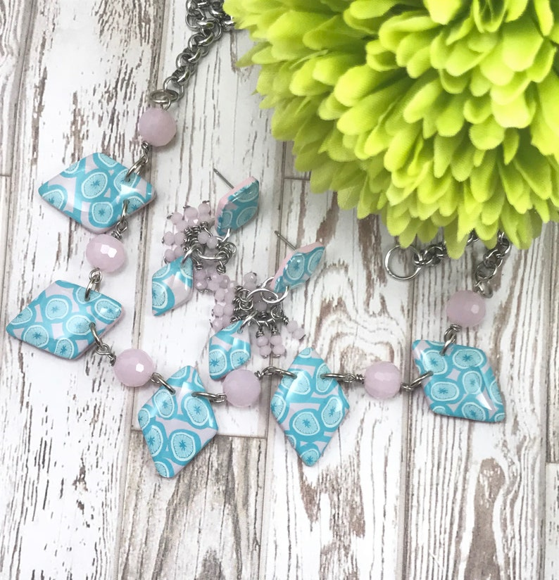 OSPTNE Pink and teal patterned polymer clay statement necklace and earring set with powder pink crystals