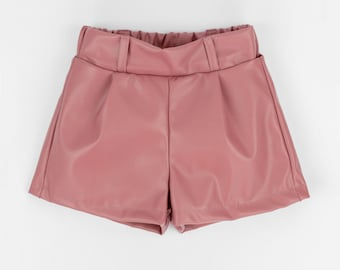Girly Pink eco-leather shorts with elasticated belt and pleats in the front.