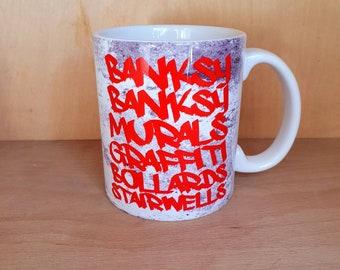 Vic & Bob mug Banksy Murals Graffiti Bollards Stairwells free-running cup coaster handmade funny comedy gift present work cup 11oz uk retro