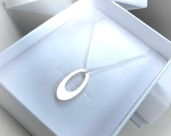 Small offset sterling silver pendant