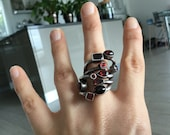 Silver snake ring and garnets