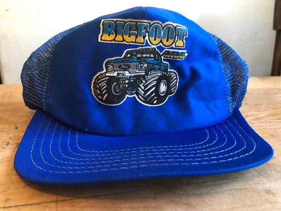 True vintage blue snapback trucker hat. Features b