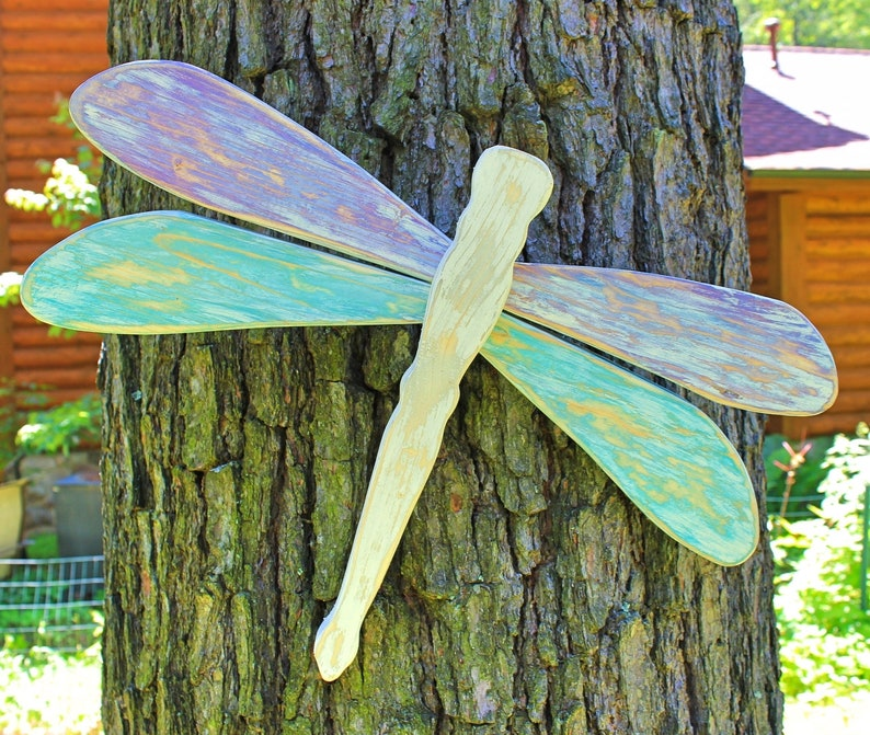 Buy some large wooden dragonflies to mount on your fence--or try to make your own! Paint them or mix and match sizes and styles to get fun and unique dragonflies. Here are some quick and easy ways to decorate your garden fence.