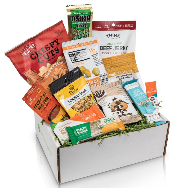 care package box with an assortment of high protein snacks a college guy will enjoy