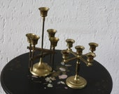 2 copper candle stands for 5 candles each. The highest is adjustable in height - in very good condition. 27 + 16 cm high