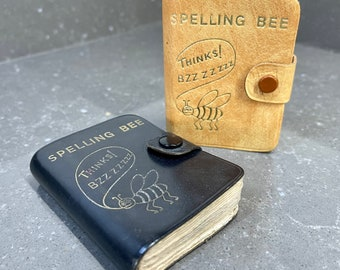 Vintage miniature leather bound Midget Spelling Bee book.