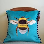 Handmade Turquoise Velvet Bumblebee Cushion Cover with Turquoise Pompom Trim