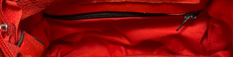 red color double inner pocket with zip and detachable strap Small clutch bag in real leather