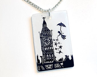 Mary Poppins pendant necklace with a linocut image of Mary Poppins flying over Big Ben and the rooftops of London