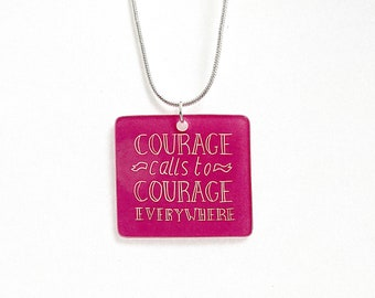 Courage Calls to Courage Everywhere linocut pendant necklace on an 18 inch silver plated snake chain. Available in blue, red, pink or green
