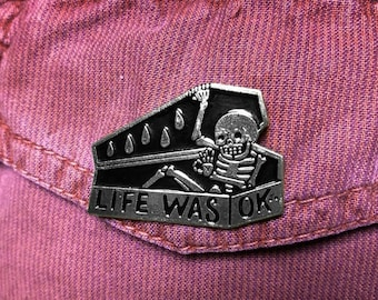 3bfe223773c Skeleton In Black Coffin Written Life Was OK Punk Gothic Dark Hat Badge  Corsage Shirt Collar Metal Brooch Enamel Lapel Pin Jewelry Gift