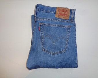6c5c49b28fc Levi's Strauss 516 blue jeans Waist 34
