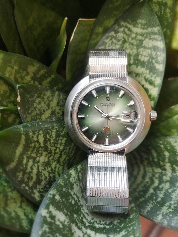 Ricoh Sakura Green Face watch