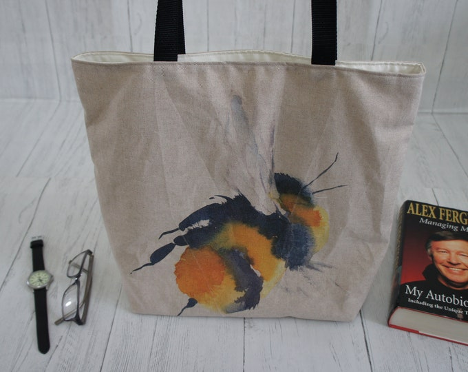 Bee Shopping Bag with internal zip pocket Strong taking 8kg, fully lined machine washable. Panel on one side at the wrong angle so reduced.