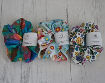 Pack of 3 Patterned colourful Scrunchies. 3 pack Hair Bobbles, 3 pack Hair Ties. Swirls. Yarn Balls. Starburst. Sent in recyclable packaging