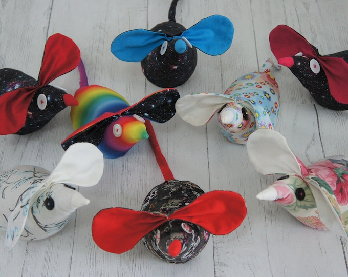 Mouse Door Stops. Cute Stargazer Mice. Wheat filled inner bag. Recycled button eyes. Varying weight, average 450g. Rainbow, Galaxy, Floral.