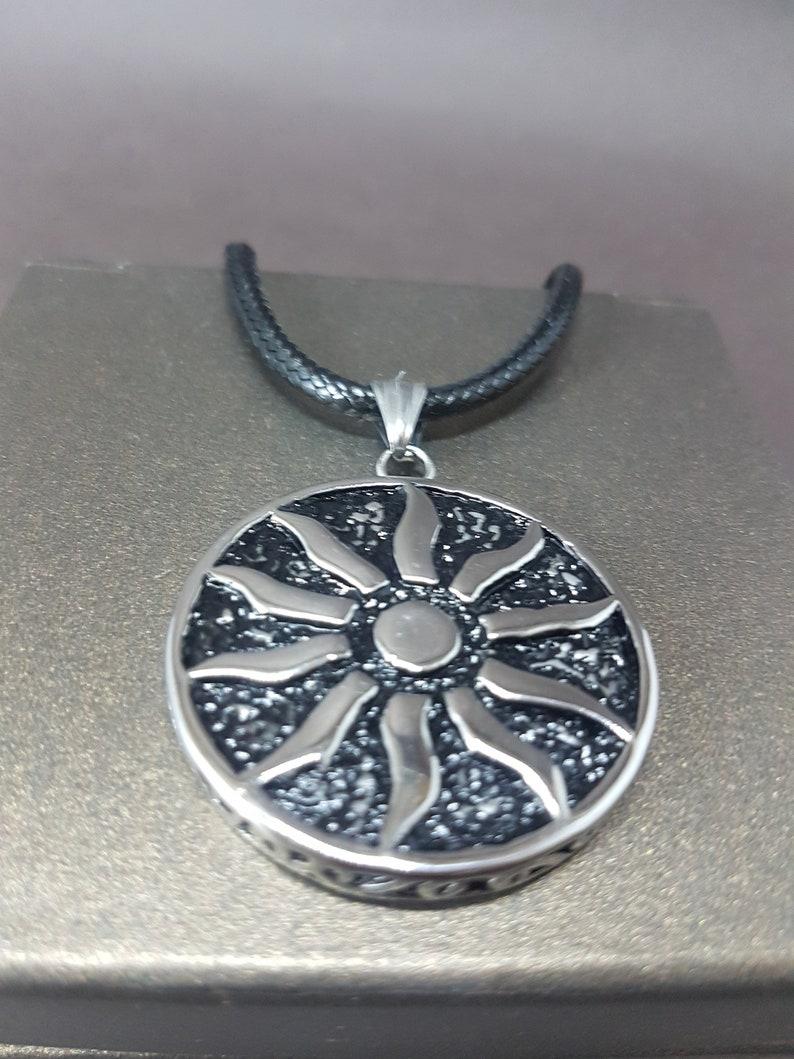 Circle pendant leather strap necklace The Sun