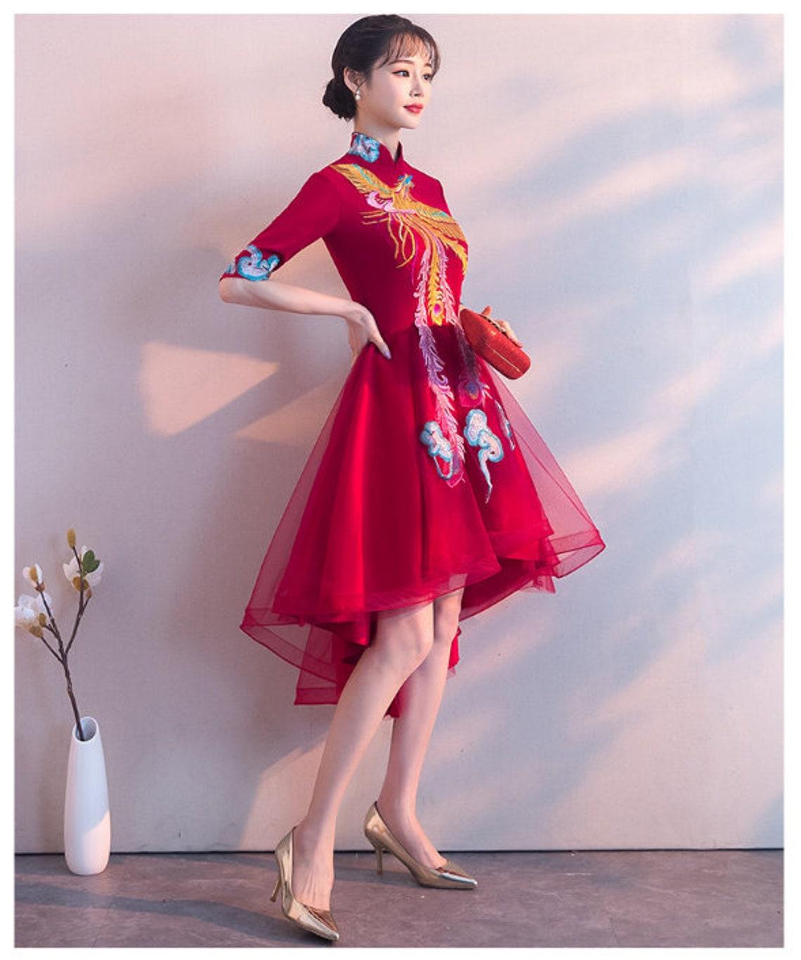 Moderne chinesische Braut rot Cheongsam Braut Hochzeit