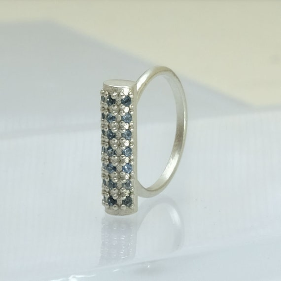 London blue topaz ring with 21 diamond cut blue topaz prong set   Tube ring   Bar ring   Barrel ring   Made by Thayer Jewelry