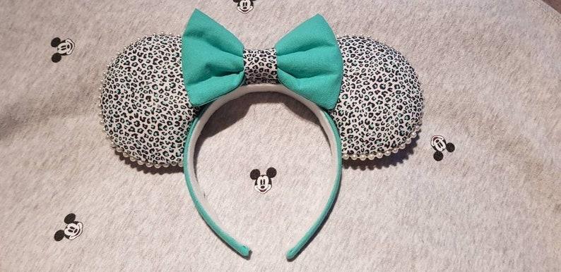 Beautiful alternative animal print mickey ears in turquoise green