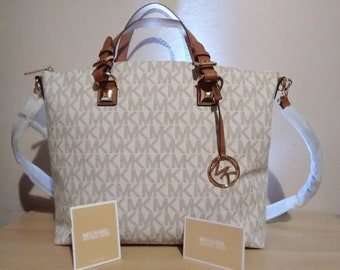 e2d02aa58d7c Michael Kors Handbag Brand New! Comes with free New Tommy Hilfiger  Backpack. Wow!