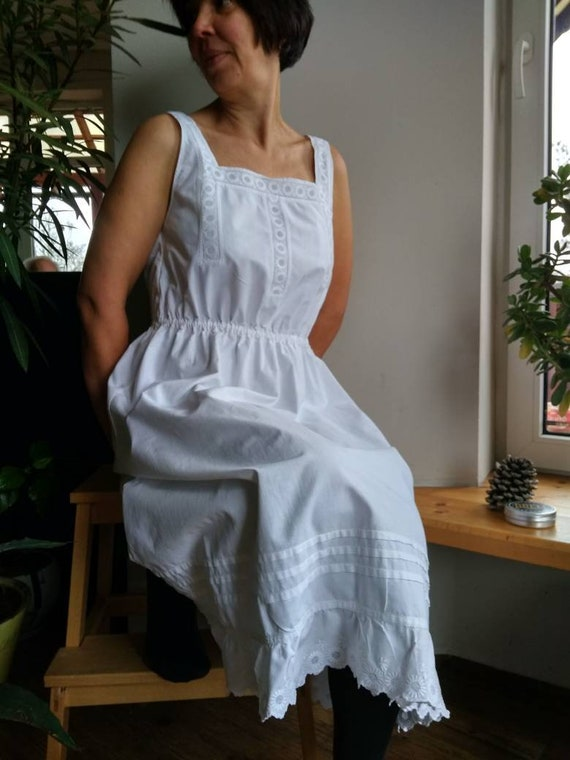 Antique white cotton night gown decorated with eye