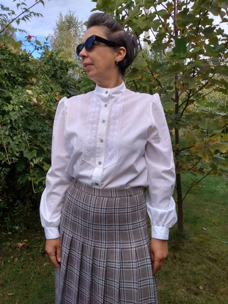Vintage 70s grey and brown plaid pleated skirt.
