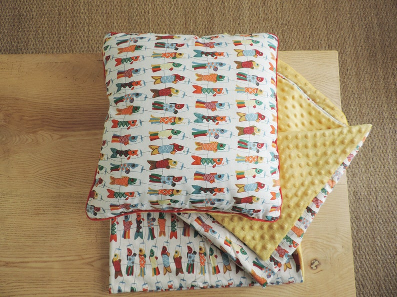 soft child in yellow minky and organic cotton printed with Japanese flying fish Blanket and cushion for baby