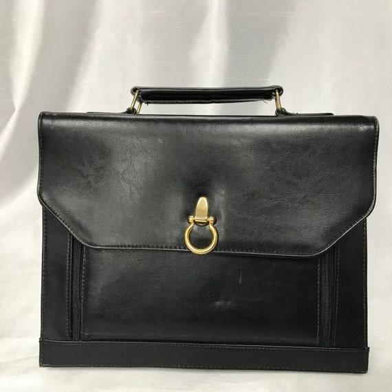 Black leather bag, black leather towel, black brie