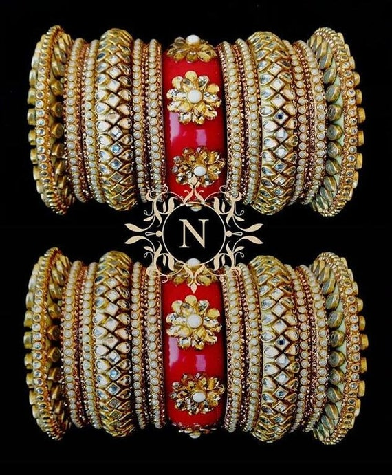 wedding bangles sabyasachi jewelry Pearl wedding jewelry bridal chooda statement jewelry gold bangles kundan Indian bridal bangles