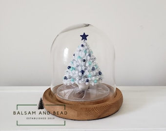 28038d92efaf76 White handmade Miniature chenille pipe cleaner Christmas tree in 7.20 in x  7.20 in glass cloche with blue, and silver round ornaments