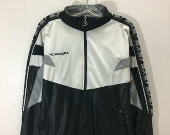 de3b68bf80c1 Vintage Diadora Light Track Jacket Size Large Black White Repeat Logo