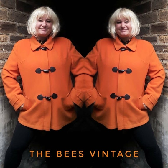 Vintage 80s bright orange wool duffel coat.