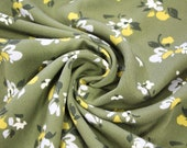 Milli Blu's viscose, olive green, white-tched yellow floral