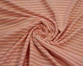 Jersey, apricot, white stripes in braid pattern