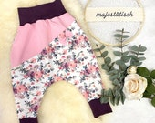Pump pants size 86, white-pink flowers, with division and bow