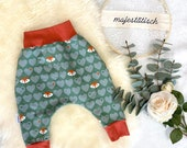 Pump pants, foxes, green-terracotta, size 74