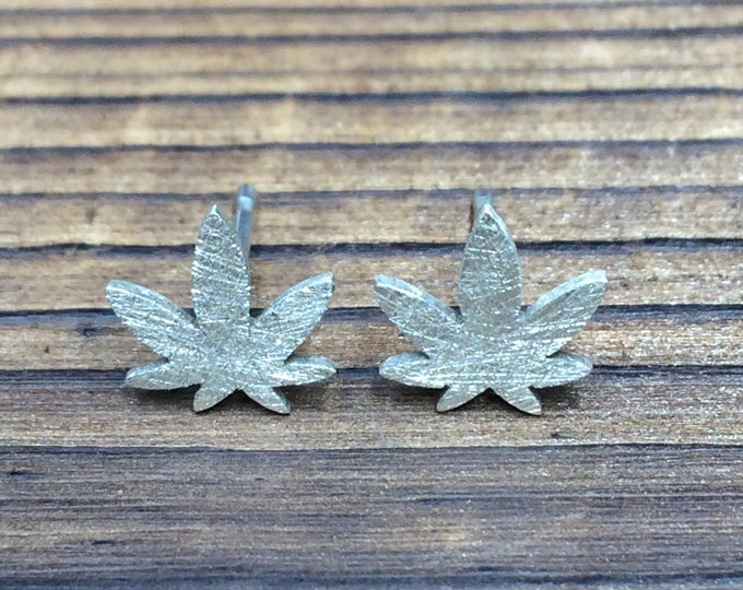 Featured listing image: Silver Ganja Leaf stud earrings - scratch finish