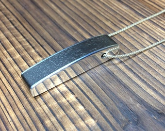 Silver and ebony curved pendant