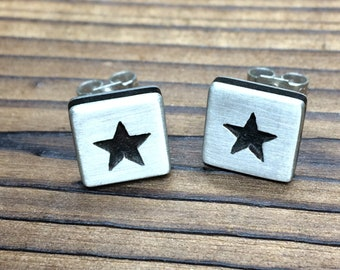 Silver and ebony satin finish star earrings