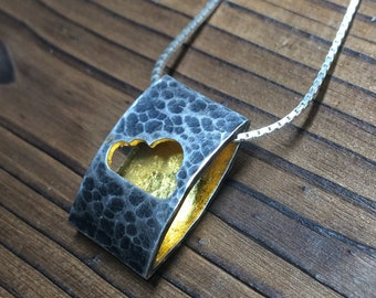 Cloud ellipse pendant - hammered, oxidised and gold leafed