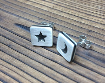 Silver and ebony satin finish star and moon earrings