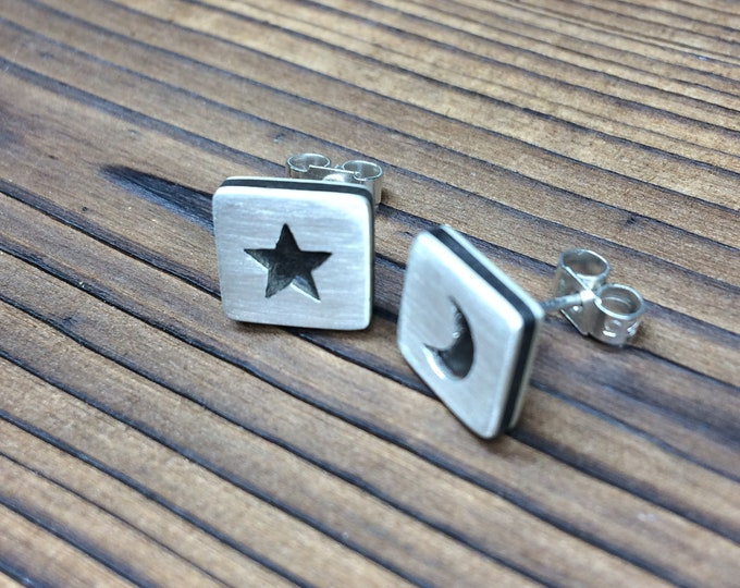 Featured listing image: Silver and ebony satin finish star and moon earrings