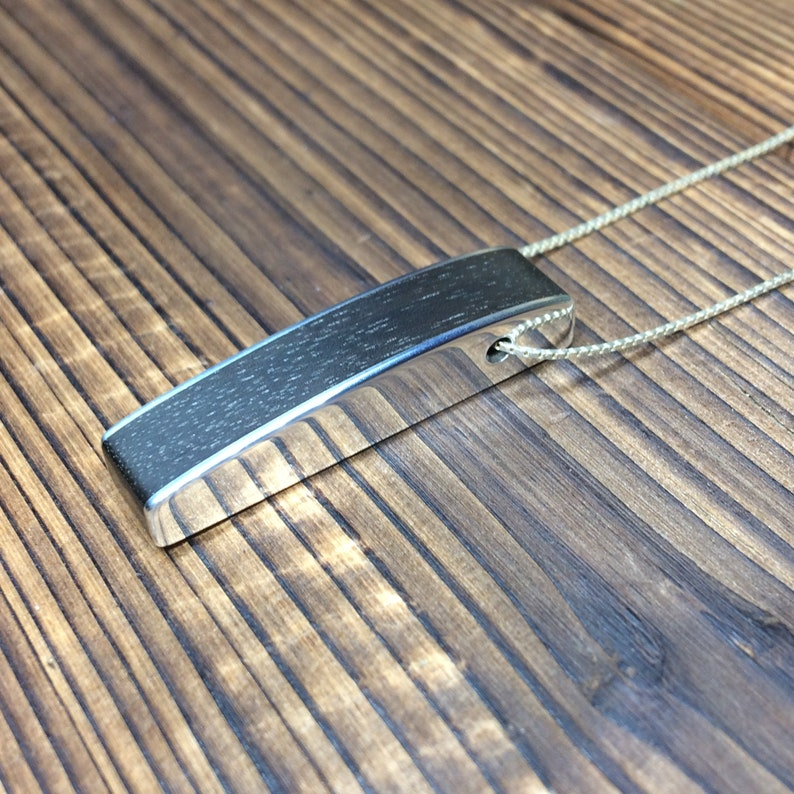 Silver and ebony curved pendant image 0