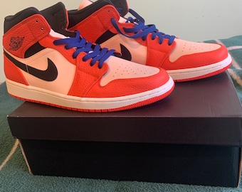 super popular ab34c 9839f Nike Men s Air Jordan 1 Mid Trainer. Comes with an air-sole unit in the heel  to provide extra cushioning.
