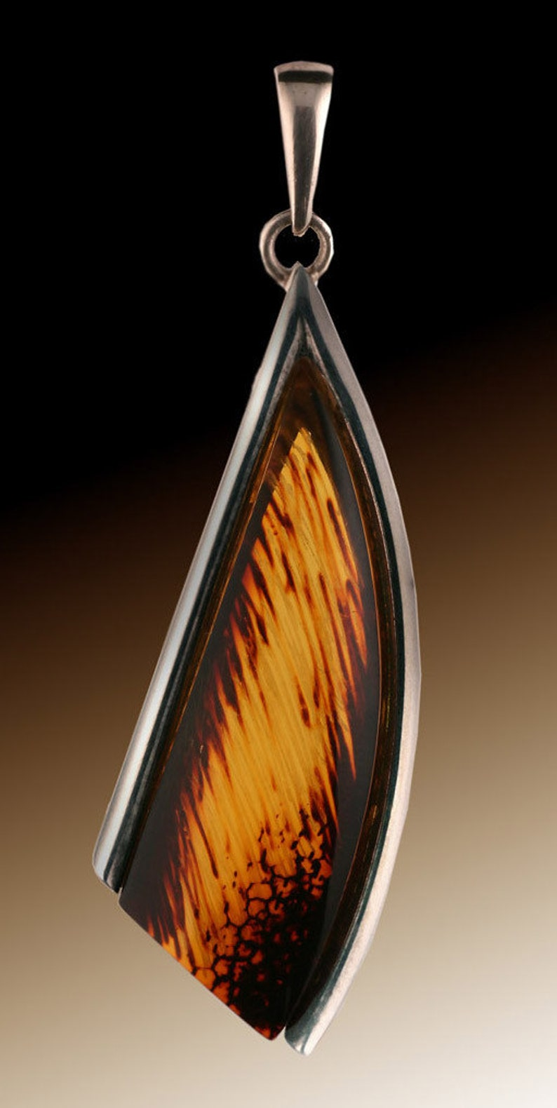 Amber Pendant...Sterling Silver surrounds 2 sides of this stunning piece of Amber jewelry