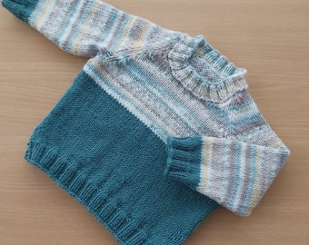 A handknitted baby sweater with long sleeves, fairisle effect yoke - 6 to 12 months - round neck