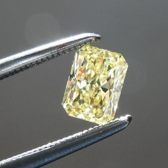 1) YELLOW ROUND 1.15 CT STONE VVS1 MOISSANITE Other Items